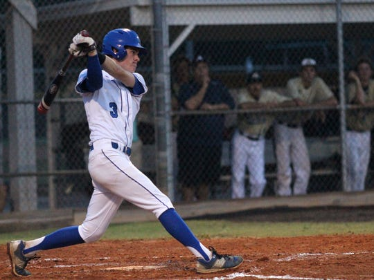 Carter Smith swings during Tuesday night's regional final between Indian Rock and Canterbury.