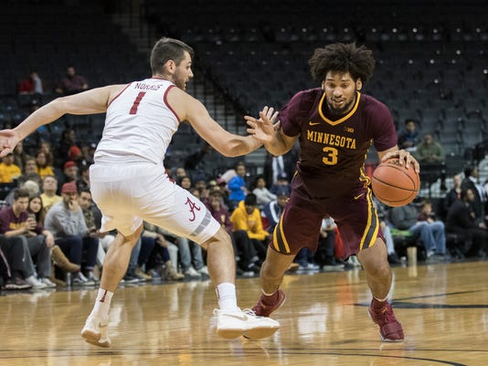 Minnesota forward Jordan Murphy (3) drives to the basket against Alabama guard Riley Norris (1) during the second half of an NCAA college basketball game, Saturday, Nov. 25, 2017, in New York. Minnesota won 89-84.(AP Photo/Mary Altaffer)