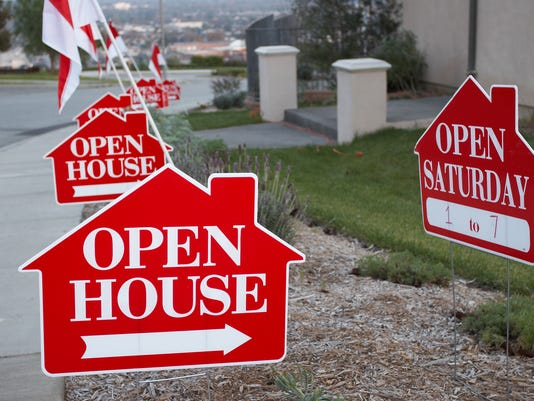 Red and white open house signs