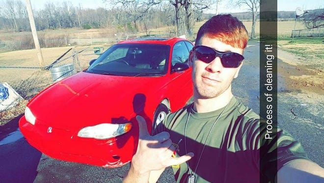 Peyton Gates, 18, poses with his car. Gates died from a gunshot wound Saturday.