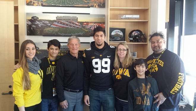 Special to the Register/Epenesa family A.J. Epenesa (99), pictured with his family and Iowa coach Kirk Ferentz, committed to the Hawkeyes. A.J. Epenesa (99), pictured with his family and Iowa coach Kirk Ferentz, committed Sunday to the Hawkeyes in January.