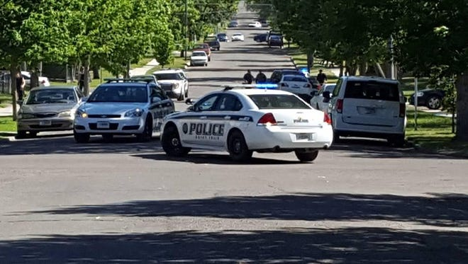 """Great Falls Police officers at the scene of a """"brief manhunt"""" Tuesday afternoon that led to the apprehension of Marshal Dubois and Justin Marceau."""