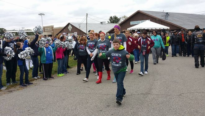 On Oct. 1, S.M.I.L.E. will celebrate its 15th annual S.M.I.L.E. Mile. Here participants gather during past year's walks.