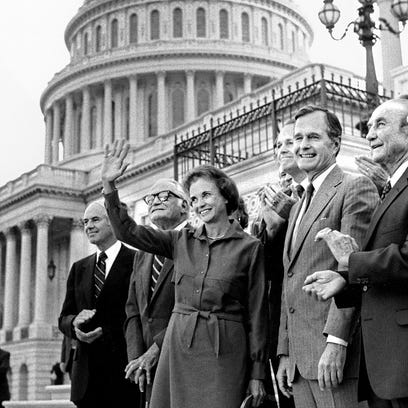 Sandra Day O'Connor waves after her unanimous confirmation