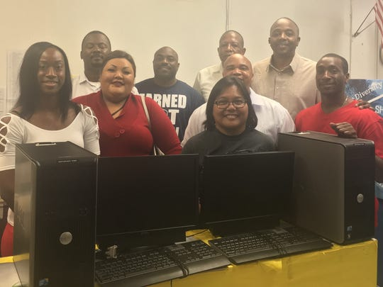 Members of the Prince Hall Masonic Family, District 8 donated two computers to Simon Sanchez High School on May 5, 2018.
