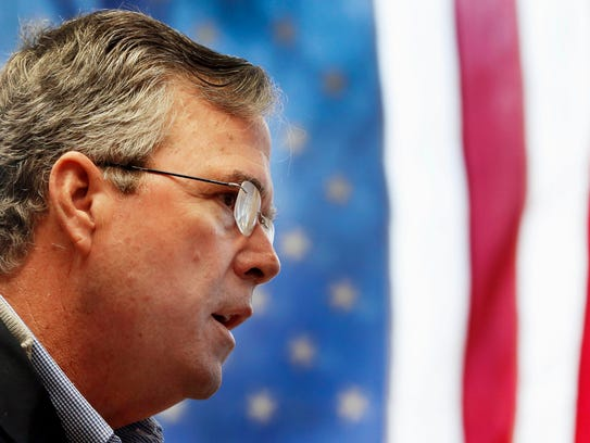 Jeb Bush speaks to employees during a campaign stop
