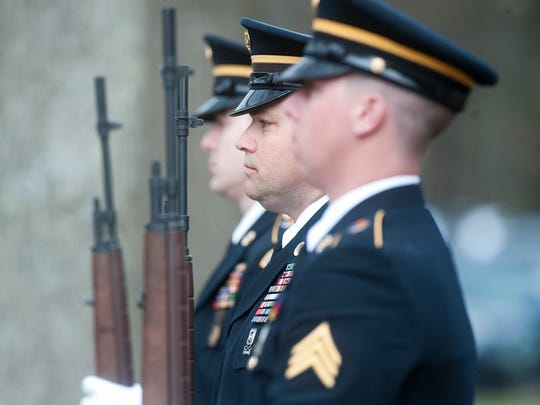 Members of a military honor guard attend the funeral of Kryn Miner at St. Lawrence Church in Essex Junction on Friday May 2, 2014.  Miner was a 44-year-old combat veteran who served with the Vermont Army National Guard.