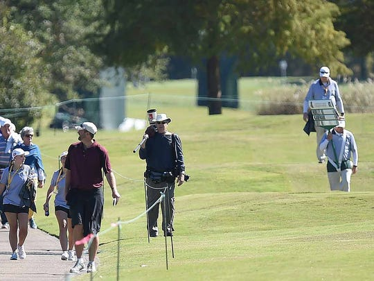 The gallery following the grouping of Hurley, Kaufman and Love make their way up the 9th fairway on Thursday, October 26, 2017, the opening day of the Sanderson Farms Championship at the Country Club of Jackson in Jackson, Miss.