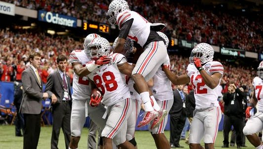 Ohio State celebrates a pick six by defensive lineman Steve Miller.