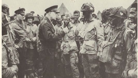 Gen. Dwight D. Eisenhower speaks with paratroopers of the 101st Airborne Division on June 5, 1944. Wausau native Bill Hayes is in the center of the photo, helmetless, behind Eisenhower's right hand.