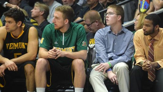 Josh Speidel sits on the Vermont bench during the Catamounts' game against Purdue.