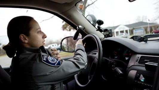 Marine City Police Officer Margie Springer uses her radio to call a traffic stop to dispatch while on patrol in 2015 in Marine City. Marine City is keeping its police department.