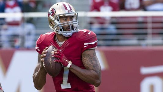San Francisco 49ers quarterback Colin Kaepernick (7) drops back to pass against the Baltimore Ravens at Levi's Stadium.