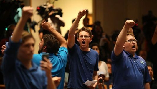 """People react as white nationalist Richard Spencer, who popularized the term """"alt-right"""" speaks at the Curtis M. Phillips Center for the Performing Arts on October 19, 2017, in Gainesville, Florida."""