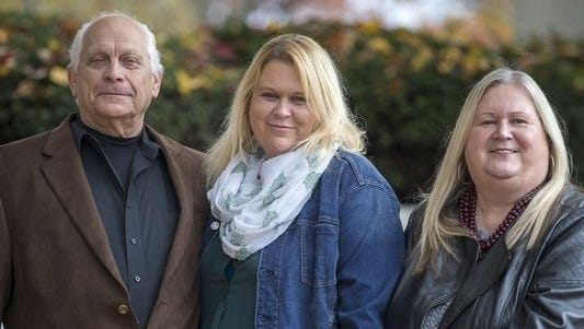 Roger Roth (left), Marcie Keithley (right) and daughter Jessica Roth (center) stand for a portrait in Jeffersonville, Ind., Thursday, Nov. 16, 2017. Marcie placed Jessica for adoption in 1978. Marcie and Roger, Jessica's birth father, rekindled their love nearly three decades later and they reconnected with Jessica in 2008. Marcie and Roger recently surprised Jessica, whose adoptive parents have passed away, with adoption paperwork to officially become her parents 39 years later.