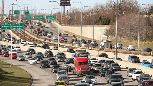 Travel backs up on the Kennedy Expressway as commuters and holiday travelers try to get an early start on their Thanksgiving travel on Nov. 27, 2013, in Chicago.