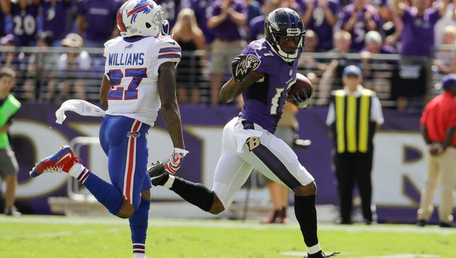 Baltimore Ravens wide receiver Mike Wallace looks back at Buffalo Bills strong safety Duke Williams (27) as he runs for a touchdown during the first half of an NFL football game in Baltimore, Sunday, Sept. 11, 2016. (AP Photo/Patrick Semansky)