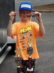 Satellite Beach's Dalton Cummins, 9, shows off the broken sunglasses that barely clung to his face when he crossed the finish line during a BMX bike race in Texas.