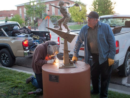 Local artists install their art along Main Street Saturday,