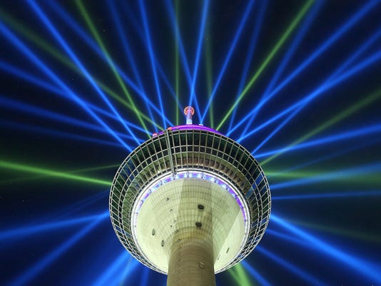 A June 26, 2017 photo shows of a light installation on the Rhine Tower during a rehearsal in Duesseldorf, Germany. The light installation promotes the start of the cycling race Tour de France  on Saturday July 1, 2017 in Duesseldorf. (David Young/dpa via AP)