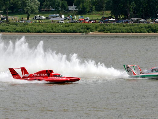 From left, Mike Kelly in the Graham Trucking and Jimmy Shane in the Oberto race for position during the final heat of the Madison Regatta in Madison, In. Kelly won the race with Shane finishing fourth. July 6, 2014