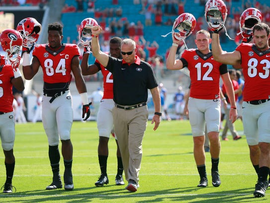 Richt and his players leave the field after falling
