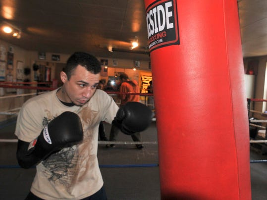 FILE - In this March 2, 2011, file photo, junior welterweight Nick Casal trains at Casal's Boxing Gym in Niagara Falls, N.Y. A little less than two years after he was assaulted on the street and sustained severe head lacerations, Casal is planning a return to the ring. On Thursday, Feb. 27, 2014, Casal will face Shakha Moore in his hometown of Niagara Falls, N.Y. (AP Photo/The Niagara Gazette, Dan Capellazzo)