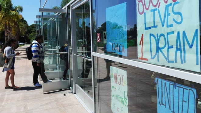 Oxnard College students enter the school's performing arts building for a DACA forum earlier this month.