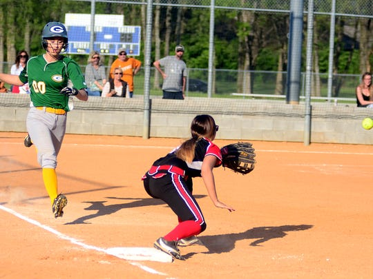Gallatin High sophomore Haley Barnes runs down the first-base line as Westmoreland junior first baseman Kiersten Powell receieves a throw during first-inning action.