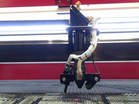 Laser cutter employed by Quality Plastics.