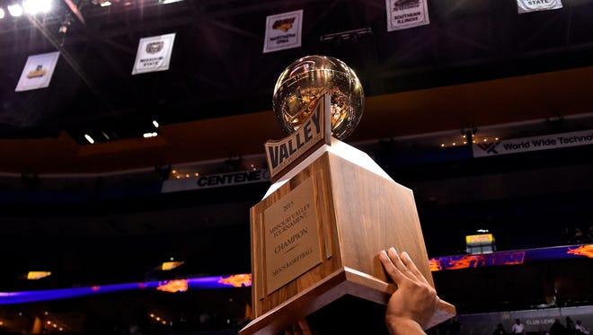 The Northern Iowa Panthers players hoist the championship trophy after defeating the Illinois State Redbirds in the championship game of the Missouri Valley Conference basketball tournament at Scotttrade Center. The Panthers won 60-69.