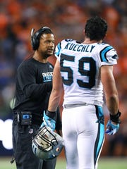Holcomb finished his fifth season as the Panthers linebackers coach and has worked with standouts such as Luke Kuechly (pictured) and Thomas Davis.