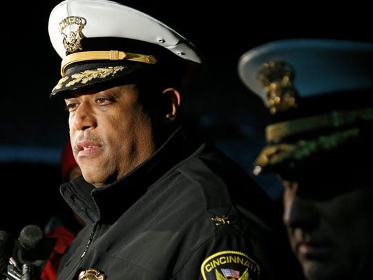 Cincinnati police Eliot Isaac briefs the media from the scene of an officer involved shooting in the West Price Hill neighborhood of Cincinnati on Monday, Jan. 11, 2016. Two officers were in pursuit of a suspect who was shot and killed when he produced a weapon, according to Isaac.