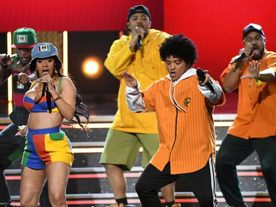 Cardi B (L) and Bruno Mars perform onstage during the 60th Annual GRAMMY Awards at Madison Square Garden on Jan. 28, 2018, in New York City.