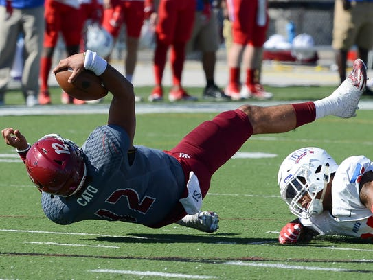 Florida Tech QB Mark Cato is upended by Montrell Pardue