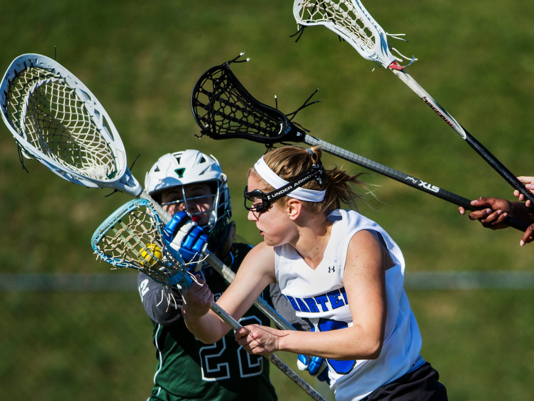 Charter's Jordan Wood cuts toward the goal as a group of Tower Hill defenders, including goalie Ellie Wakefield (left), raise their sticks in defense in the second half of Charter's 10-9 win over Tower Hill at Charter School of Wilmington on Tuesday afternoon.