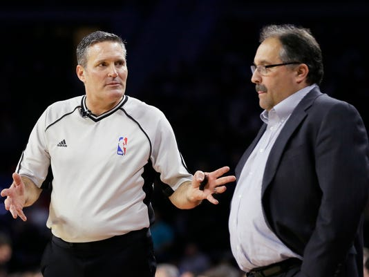In this Feb. 21, 2016, photo, referee Monty McCutchen talks with Detroit Pistons head coach Stan Van Gundy during the first half of an NBA basketball game against the New Orleans Pelicans in Auburn Hills, Mich. McCutchen is now working in the league office and is tasked with trying to get referees and players to get along better. (AP Photo/Carlos Osorio)