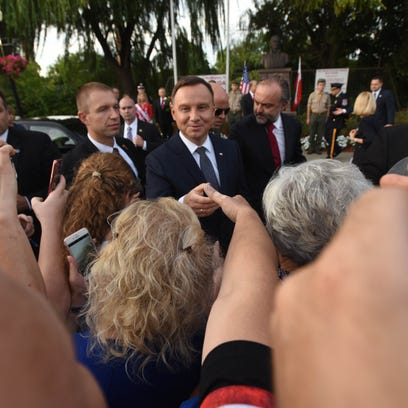 Residents greet Polish president Andrzej Duda, during