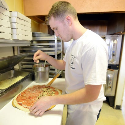 Vinny Buzzetta makes a pizza at Picnic Pizza on Maple