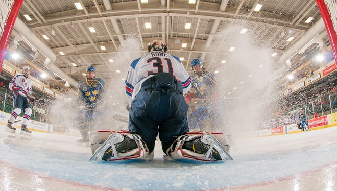 Team USA goalie Cameron Rowe covers up the puck during 2017 World Under-17 Hockey Challenge quarterfinal Nov. 9 against Sweden.