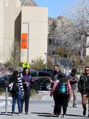 UTEP students walk on campus during a class change