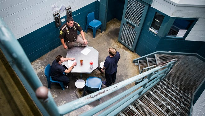Sheriff Ray Dudley chats with inmates inside of a cell block at the Delaware County Jail.