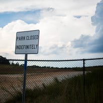 """M.J. """"Dolly"""" Cooper Park in Powdersville, with its fence locked Tuesday, has been closed indefinitely."""