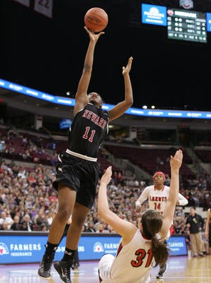 Newark's Kym Royster goes to the hoop for two Friday against Lakota West during a Division I state semifinal.