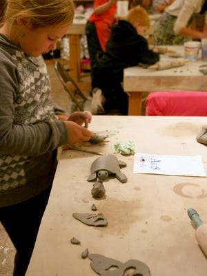 Kristen Rauch working on a turtle project during Kids After School Clay last spring at Great River Arts in Little Falls.