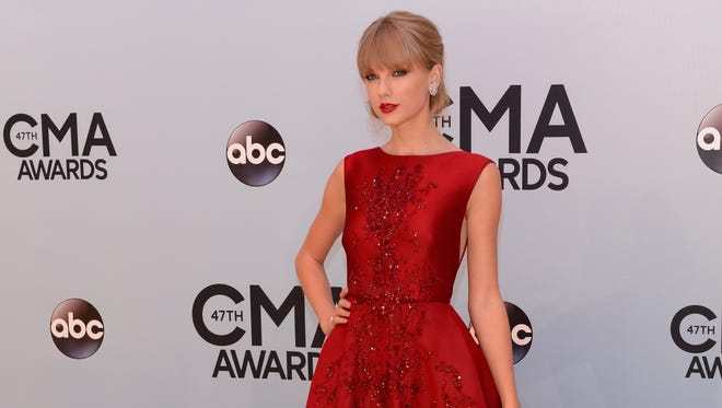 Taylor Swift arrives at the 47th annual CMA Awards in Nashville.