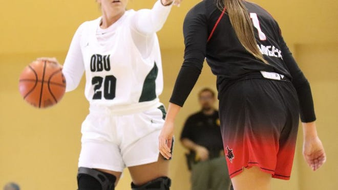 Former Shawnee High School standout and current Oklahoma Baptist University Bison player McKenzie Cooper (20) directs the offense during a game earlier this season against Northwestern Oklahoma State. The OBU women and men return to Great American Conference play at Henderson State tonight.