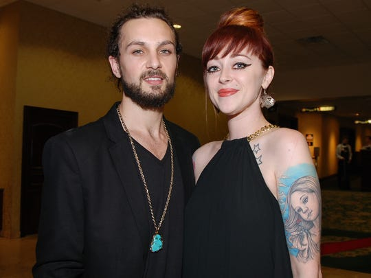 Jon Mayfield and Renee Yohe pose for a photo during