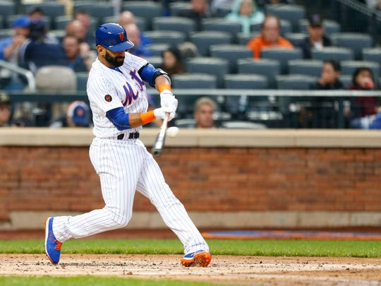 Mets new left fielder Jose Bautista (11) hits a double in the second inning against the Miami Marlins at Citi Field, his debut as a Met, on Tuesday, May 22, 2018.