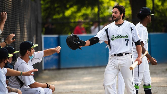 The Bravehearts' Aidan Wilde receives congratulations after hitting a home run last month.